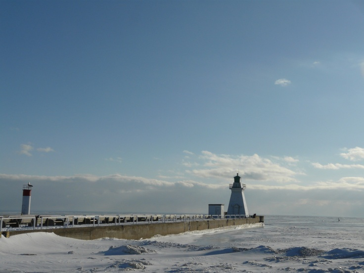 Two lighthouses in winter, at the mouth of the harbour. Port Dover, Ontario. @Valerie Hilliard Tourism. Photo by E. Cline Beveridge.