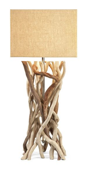 The Explorer Drift Wood Table Lamp features a base made from natural driftwood and a rectangular jute shade.