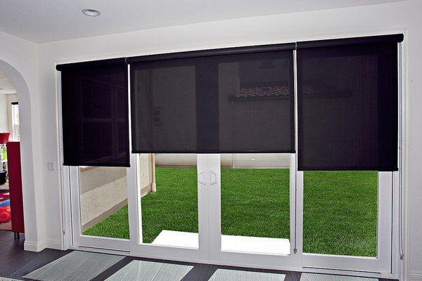 Roller shades on a sliding glass door