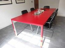 Dynamobel 'Neta' meeting table in red laminate finish with centre lift-up cable access flaps. Very good condition.