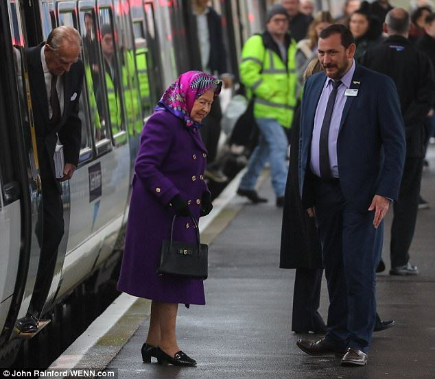 Home for Christmas!The Queen and the Duke of Edinburgh arrive at King's Lynn station to k...