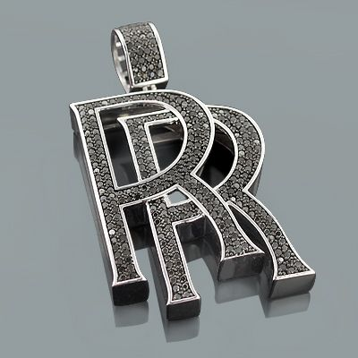 Trendy Black Diamond Jewelry: This Custom Made RR Pendant for Men in sterling silver weighs approximately 62 grams and showcases 11.10 carats of dazzling round diamonds. Featuring an iced out design with a shiny metal outline, this men's diamond pendant in sterling silver is an affordable alternative to expensive gold jewelry and can be custom made with different color diamonds and in any type of metal; please contact us for details. Chain must be purchased separately.