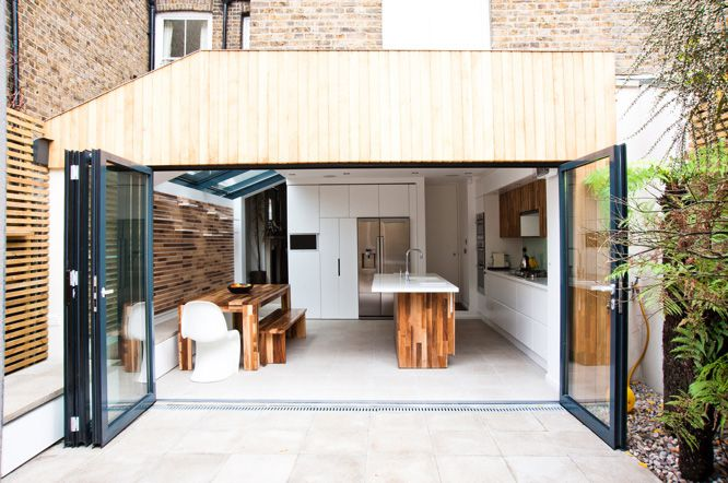 There is old saying that 'dogs often resemble their owners', well this could possibly be said about houses too. In this case Jonny and Val were keen to open up their small dark existing kitchen extension into a light modern informal space for cooking and dining as well as a place for the family to hang out. The result was a bright, open, relaxed and warm family room, a space that we hope they don't mind us saying is not unlike the owners!