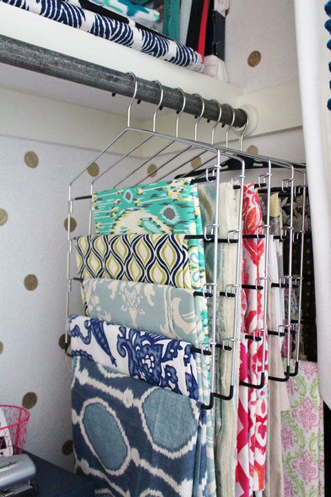 Such a sensible and inexpensive way to store fabric! I have a bunch of these hangers around the house. Now I just need the closet space. :)