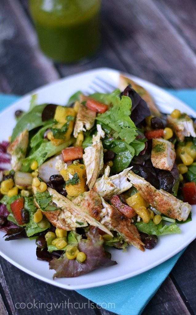 This is my Southwest Chicken Salad Summer version with fresh mangoes added to the black bean salsa and features a Cilantro Lime Dressing | cookingwithcurls.com