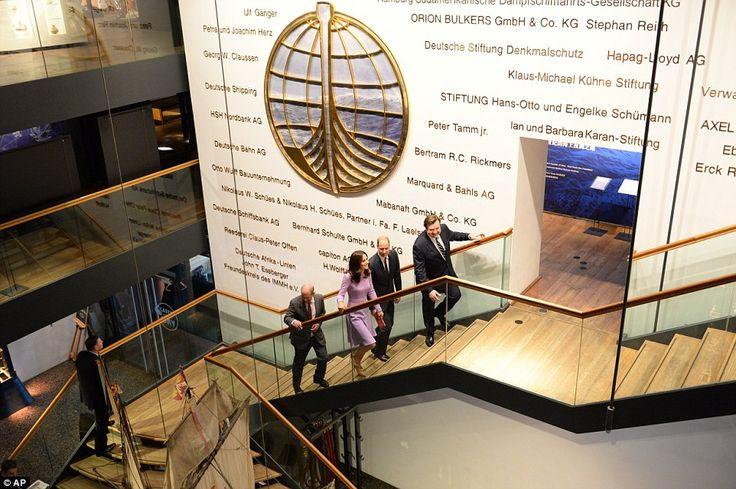 Hamburg MayorOlaf Scholz (far left) andDirector of the Maritime Museum, Peter Tamm Jr (f...