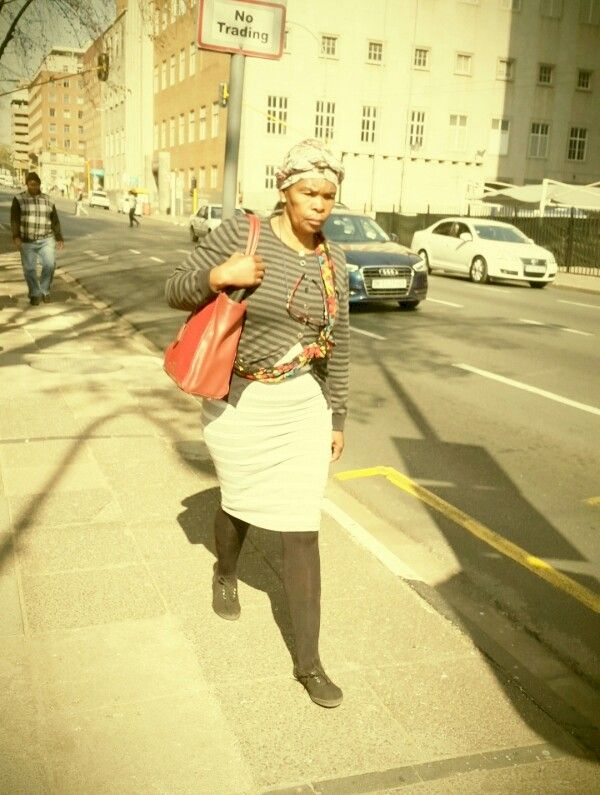 Lady in town. Johannesburg city. Lomography. Photo overlay