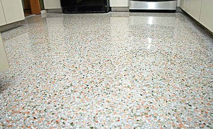 A nice Terrazzo Floor in a kitchen ~ This site dicusses the pros and cons of terrazzo.