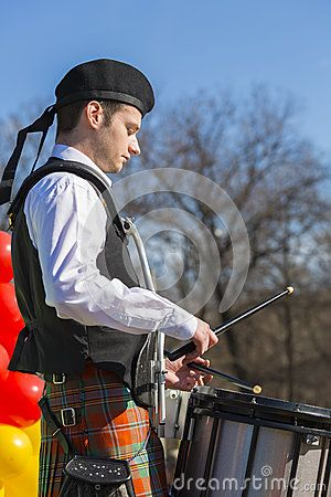 St. Patrick's Day Parade. Young man wearing traditional Irish clothes plays the drum during the 2nd St. Patrick's Day Parade on March 16, 2014 in Bucharest, Romania.Download this Editorial Stock Photo of Young Irish Drummer for as low as 0.68 lei. New users enjoy 60% OFF. 22,147,250 high-resolution stock photos and vector illustrations. Image: 38907253