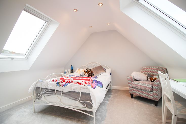 Thanks to a loft conversion this family now has so much more space to themselves: this trendy new bedroom is the perfect spot to get away from the stress and drama of teenage life. Check out the incredible slanted roof.