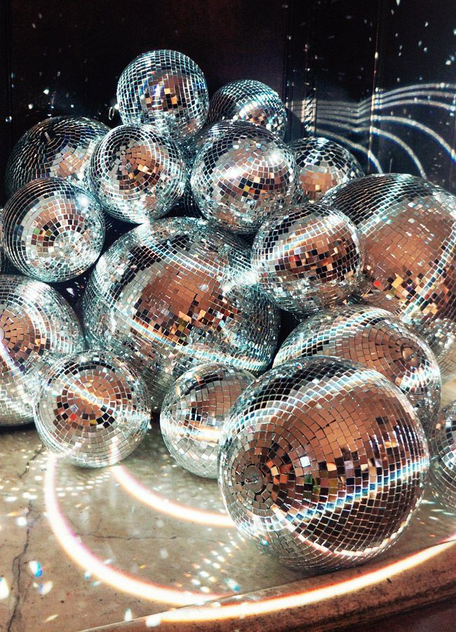 disco balls in the fireplace. photo by shauna haider.