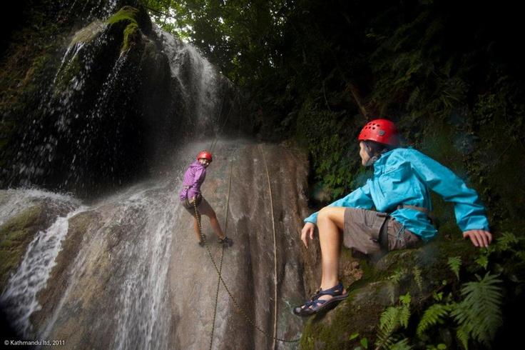 Abseiling down a waterfall in Vanuatu