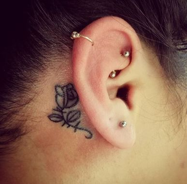 This sweet little rose tattoo by Victoria Castellanos is nearly a secret ... unless the wearer tucks back her hair.