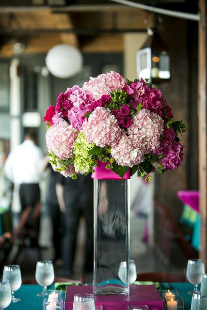 gorgeous tall pink hydrangea centerpiece | clear square tall vase with simple pink ribbon wrapped at top | bridal blush pink + hot pink + green hydrangeas