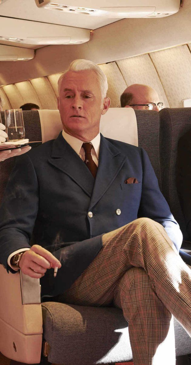 """Still of John Slattery in """"Mad Men""""   Navy double-breasted jacket with tan/patterned pants, pale shirt, dark colored tie and pocket square"""