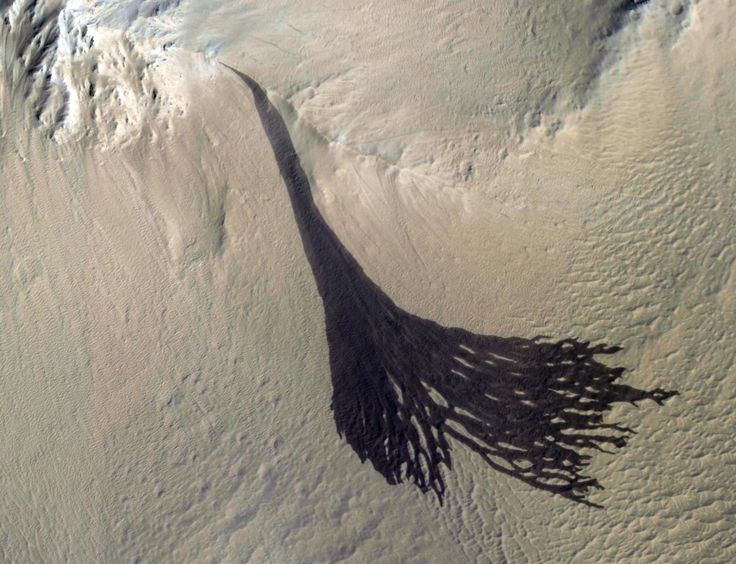 February 08 2018 : Splitting Slope Streaks This image from NASA's Mars Reconnaissance Orbiter (MRO) shows streaks forming on slopes when dust cascades downhill.