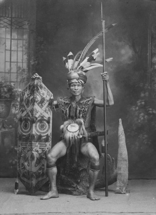 A Dayak chief, complete with amazing headdress, costume and weaponry.         Supposedly some of my ancestors were of royal blood from the Dayak tribes of Borneo!? I love this image - thank you Wikipedia for schooling me in my history  x
