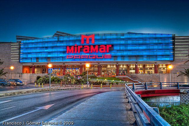 Facade of a shopping center at dusk. (Fuengirola, Costa del Sol, Spain)  Vista, al atardecer, desde el puente que cruza el río Fuengirola de este centro comercial.  ---------------------------------------------------------------------- -------------- camping in Minnesota holidays in california vacation for single shopping center to traveller europe tour travel