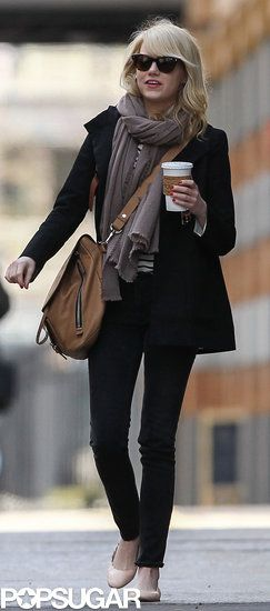 Emma Stone and Andrew Garfield Grab a Bite in the Big Apple: Emma Stone waved after getting breakfast with her boyfriend, Andrew Garfield, in NYC.   : Emma Stone carried a coffee in NYC.