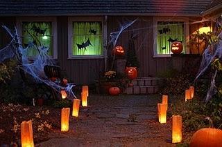 halloween outside lighting. Maybe wrap orange tissue paper around flame less votives for orange glow