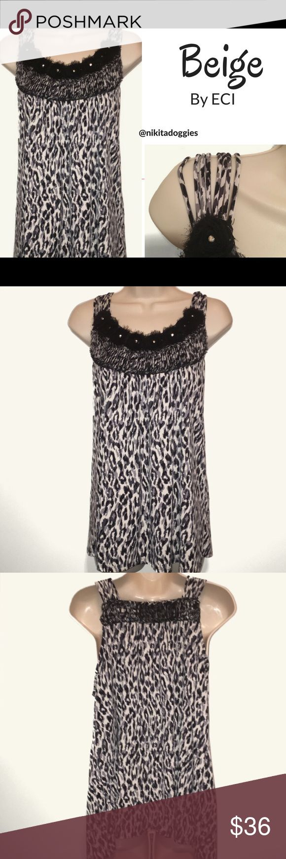"""ECI Beige Black White Animal Print Strappy Straps ECI Beige brand- Black white & gray animal print loose fitting flowing sleeveless camisole tank. Strappy shoulder straps are super cute!  Front panel black lace flowers beaded centers & gathered pleated beneath. High back with matching black lace embellishment and pleating. Really feminine and flattering!  Like new condition- no flaws/signs of wear. Armpit to armpit measures 19"""", shoulder to hem is about 27"""". Smoke free home. .04.wg.2.19 ECI…"""