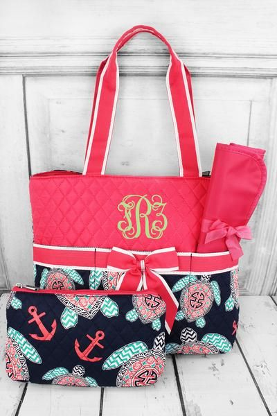 This cute diaper bag is perfect as a gift or to carry around for your little one! Quilted and adorned with a grosgrain ribbon bow, this bag is a perfect addition to your baby collection! Preppy Under the Sea Quilted Diaper Bag with Hot Pink Trim #TUL2121-HPINK