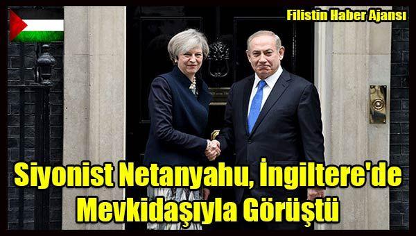 """İngiltere'nin başkenti Londra'da temaslarda bulunan Korsan İsrail Başbakanı Binyamin Netanyahu, İngiliz mevkidaşı Theresa May ile görüştü.  Başbakanlık ofisi """"10 Numara""""da başlayan görüşmede, İsrail tarafının İran'a yönelik yaptırımların artırılması konusunu gündeme getirmesi bekleniyor.   #filistin haber #israil ingiltere ziyaret #israil netanyahu #londra israil ingiltere netanyahu #netanyahu may ingiltere #siyonist israil"""