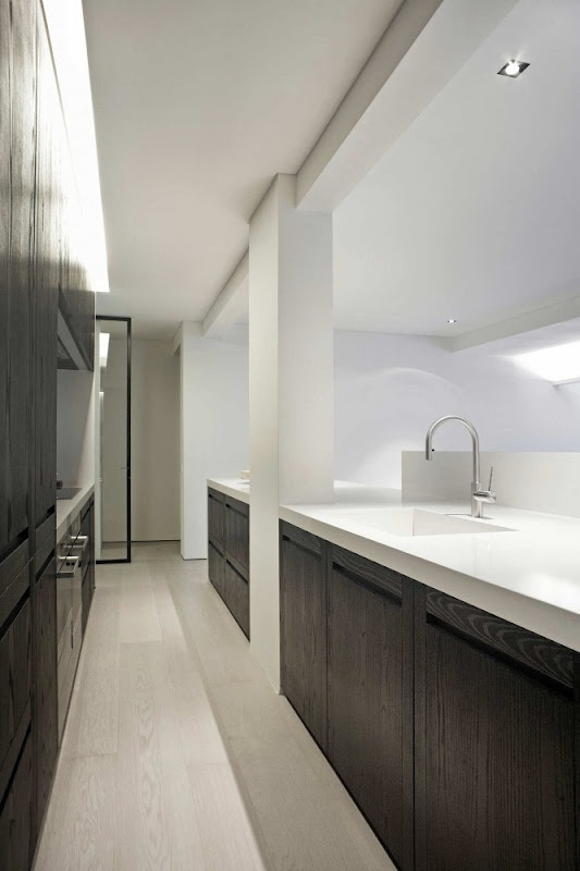 the balance… whitewash floors, white walls, black cabinets with white benchtop.
