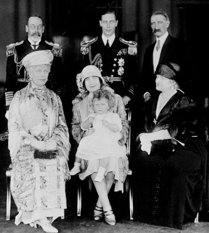 Princess Elizabeth of York (the present Queen Elizabeth II) with her parents, the Duke and Duchess of York (later King George VI and Queen Elizabeth), her maternal grandparents, the Earl and Countess of Strathmore, and her paternal grandparents, King George VI and Queen Mary