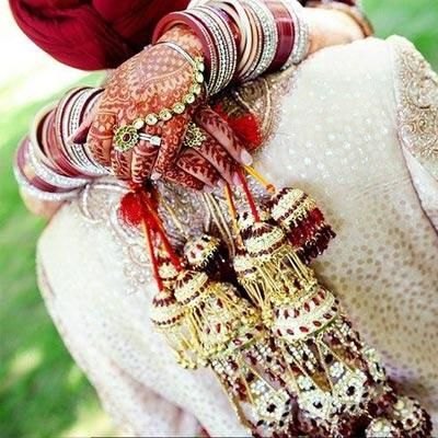Golden and red stone studded kaliras with gold hangings. Image- Pinterest via Gurleen - bollywoodshaadis.com
