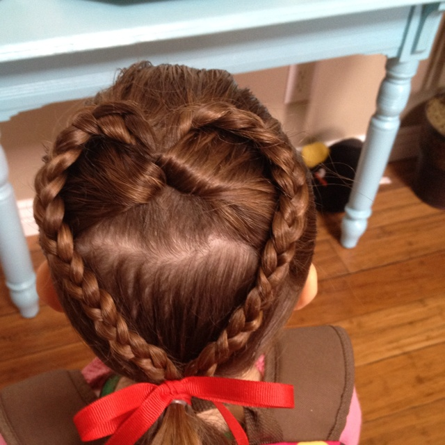 Kaileys heart hairdo for her valentines party! Just a half pony flip through braided :) cute and easy!