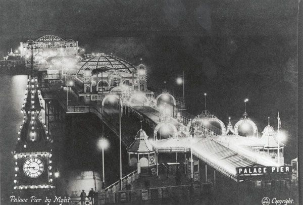 Archive black white photograph of the Palace Pier in Brighton, East Sussex at night (1917)