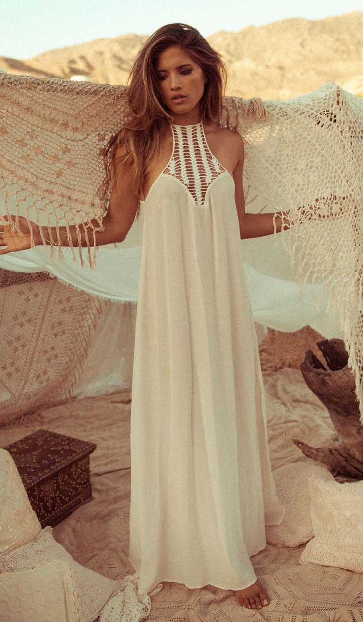 Bring your inner beach goddess out to play in Acacia's Moscow Cover Up Dress, a truly glorious confection of drapery and flow. This maxi dress beach cover up combines a plunging neckline, an intricate