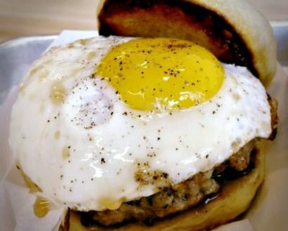 "Burger"" at Miles End: Veal sausage, an over-easy egg, cheddar, apple ..."