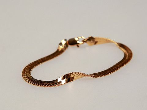 Sleek Bracelet Gold: A splendid bracelet that adds instant sophistication to any outfit. $30.00
