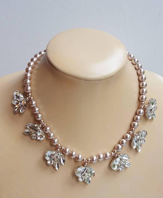 Check out this item in my Etsy shop https://www.etsy.com/ca/listing/535485056/pearl-and-rhinestone-necklacewedding
