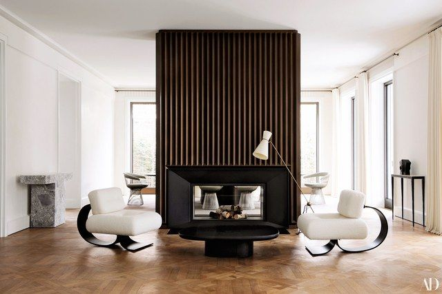 For clients in Germany, architect Joseph Dirand created a fluted marble chimneypiece.