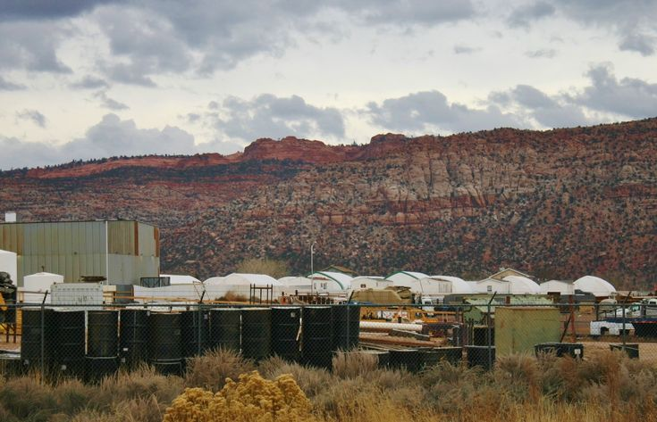 The tops of the tents and trailers in a city-built encampment can be seen from state Route 389, Colorado City, Arizona, Dec. 12, 2014 | Photo by Cami Cox Jim, St. George News