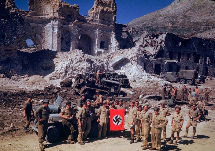 British and South African soldiers hold up a Nazi trophy flag while combat engineers on bulldozers clear a path through the debris of a bombed-out city, Italian Campaign, World War II. Read more: World War II in Color: The Italian Campaign and the Road to Rome, 1944   LIFE.com http://life.time.com/history/world-war-ii-in-color-photos-italian-campaign/#ixzz3L1XFV8qX