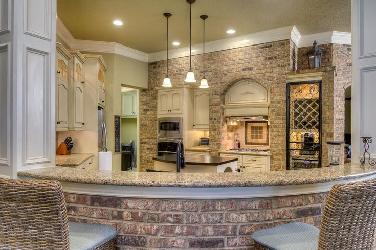 Love exposed brick walls in the kitchen!