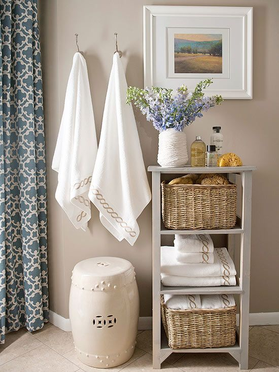 Neutrals offer a realm of possibilities in the bathroom. Look to warm and cozy taupe wall paint to pair with light greens, pinks, and blues, such as with this room's shower curtain and artwork. The soft hue makes even the smallest spaces feel luxurious and serene. Paint Color: Kid Gloves, Benjamin Moore
