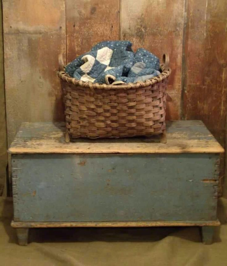 old chest w/basket. Be very neat at the foot of a bed.