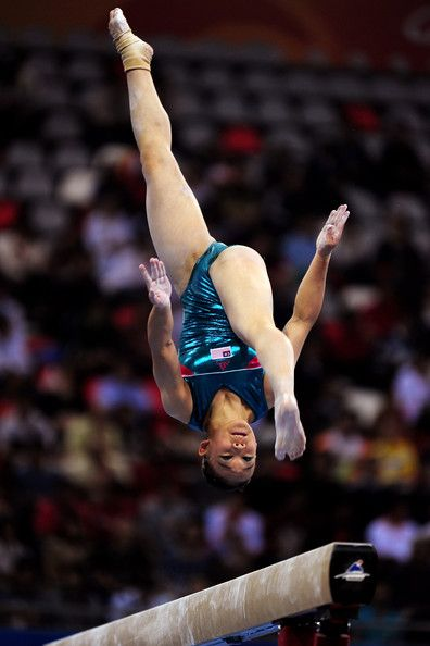 Ang Tracie of Malaysia competes in The Beam in the Women's All Round Individual Artistic Gymnastics at Asian Games Town Gymnasium during day three of the 16th Asian Games Guangzhou 2010 on November 15, 2010 in Guangzhou, China. - 16th Asian Games - Day 3: Artistic Gymnastics.