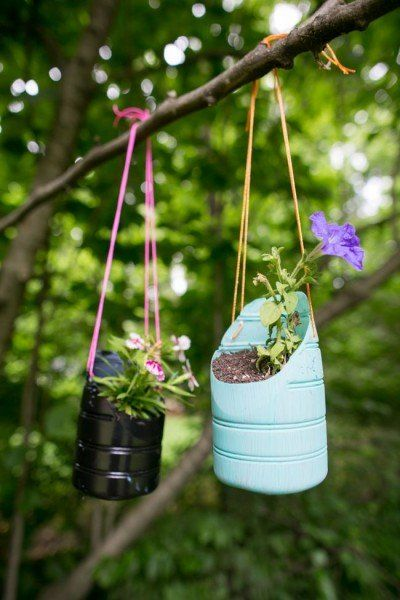 DIY Hanging Planters Made from Recycled Bottles Great fun for children to make and hang. They can water and watch their garden grow.....