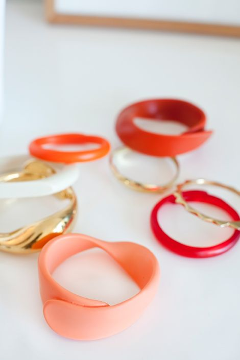 Dinosaur Designs Red Collection 2014 - various Seaweed & Shell Wrap bangles Photographed by Eryca Green