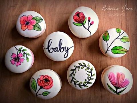 Rebecca Jane Sugar Art Handpainted floral macarons for a baby shower. Raspberry and salted caramel flavour. #macarons #paintedmacarons #babyshower #christchurch #rebeccajanesugarart #handpainted #floral #edibleart