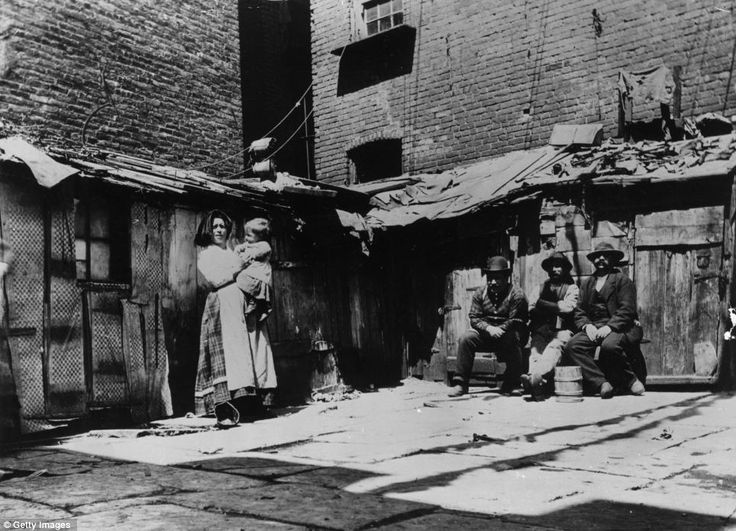 Slumdogs: The sight of Italian immigrant families in New York on Jersey Street, living in shacks could be a scene from the developing world today.