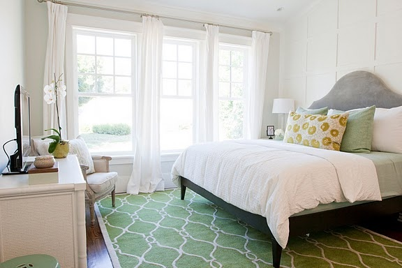 Beautiful Bedroom Wall Trim, Green Area Rug, And Pillows