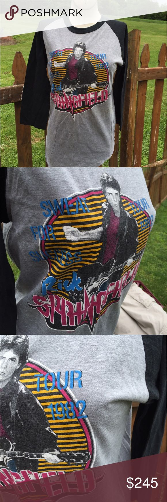 """Vintage Rick Springfield Concert Tour Raglan Shirt Super rare. Thin 50/50 blend Raglan concert shirt from 1982. Measures: pit to pit: 17"""". Bottom of the collar in the back to the bottom of the shirt: 28"""". Very nice vintage shirt. Be sure to view the other items in our closet. We offer both women's and Mens items in a variety of sizes. Bundle and save!! Thank you for viewing our item!! Vintage Tops"""