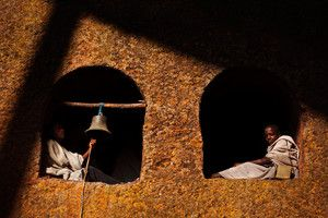 Young boys sit in the bell tower of Beta Maryam rock church. Lalibela is often referred to as Ethiopia's Jerusalem. It is one of the most sacred places for Ethiopian Orthodox Christians. The small town is most famous for its architectural marvels, the ancient rock churches, some of which were carved out from a single rock.